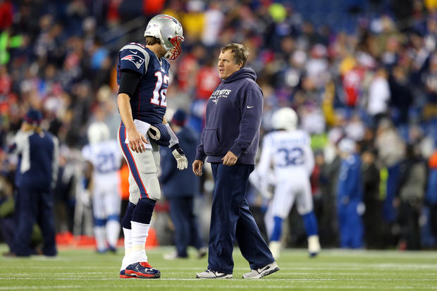 New England Patriots quarterback Tom Brady talks with head coach Bill Belichick before the AFC championship game against the Indianapolis Colts at Gillette Stadium Jan. 18, 2015, in Foxboro, Massachusetts.