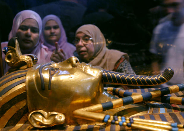 Women look at one of the coffins of King Tutankhamun at the Egyptian museum in Cairo