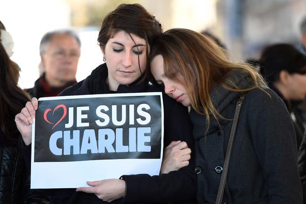 People hold a sign reading ''I am Charlie'' after observing a minute of silence in the old Harbor in Marseille