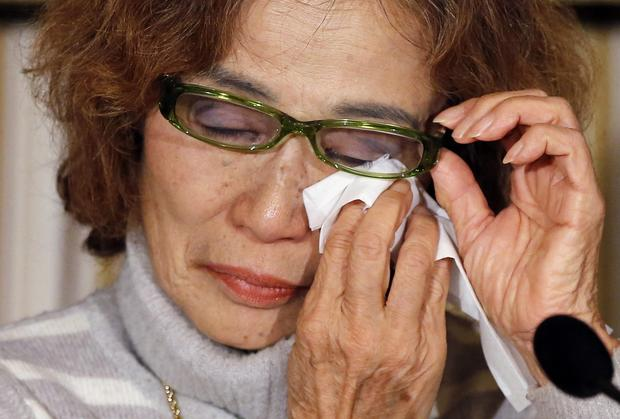 Junko Ishido, mother of Kenji Goto, a Japanese journalist being held captive by ISIS militants along with another Japanese citizen, reacts during a news conference at the Foreign Correspondents' Club of Japan in Tokyo January 23, 2015