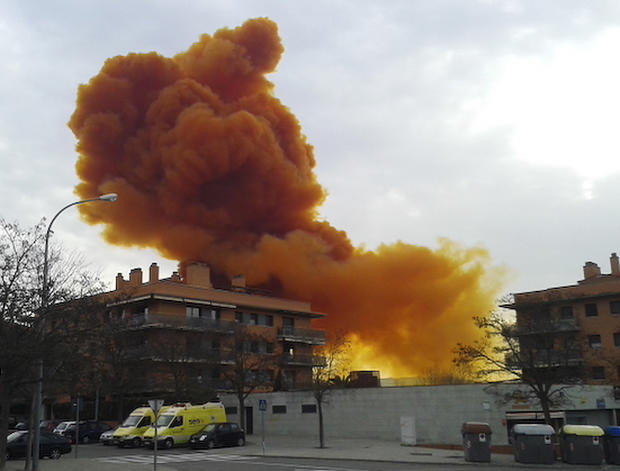 An orange toxic cloud is seen over the town of Igualada, near Barcelona, following an explosion in a chemical plant Feb. 12, 2015.