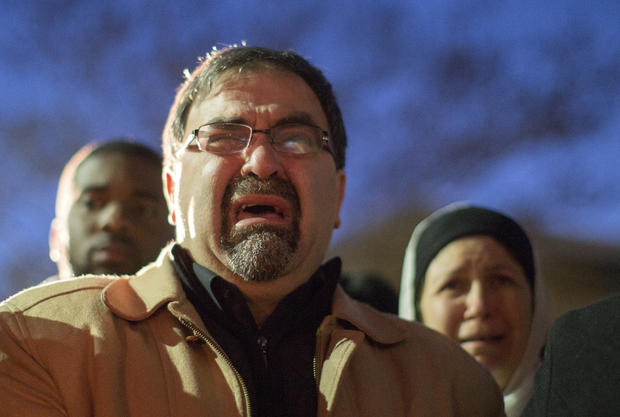 Namee Barakat, father of shooting victim Deah Shaddy Barakat, cries as a video is played during a vigil on the campus of the University of North Carolina in Chapel Hill, North Carolina, Feb. 11, 2015.