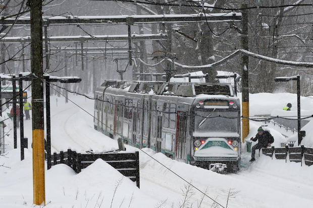 A Massachusetts Bay Transit Agency green line subway train sits at a station during a winter snow storm in Brookline, Massachusetts, Feb. 9, 2015.