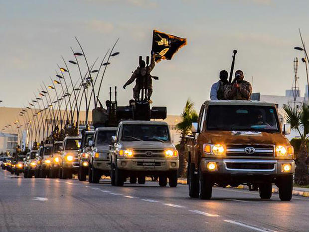 ISIS militants drive in procession through the northeastern Libyan city of Sirte