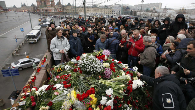 People gather at the site where Boris Nemtsov was recently murdered with St. Basil's Cathedral seen in the background in central Moscow Feb. 28, 2015.