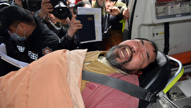 Kim Ki-jong, member of pro-Korean unification group who allegedly attacked U.S. Ambassador to South Korea Mark Lippert at public forum, is carried on stretcher from ambulance after being brought to hospital in Seoul on March 5, 2015