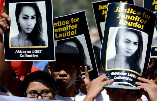 Supporters of the late Jennifer Laude hold up her image during a protest near a Philippine court in Olongapo, north of Manila