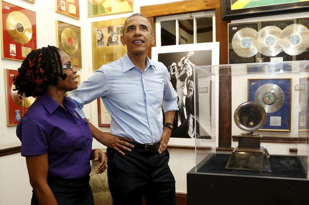 President Obama gets a tour of the Bob Marley Museum from a staff member Natasha Clark in Kingston, Jamaica