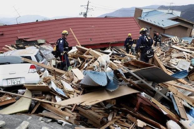 japan-riley-combing-wreckage-ap.jpg