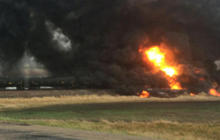 Town evacuated after oil train derails