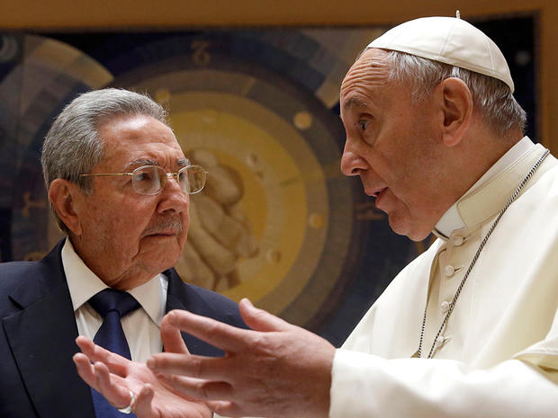 Pope Francis talks with Cuban President Raul Castro during a private audience at the Vatican
