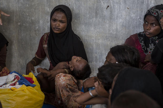 Rohingya women and children are seen after arriving at the port in Julok village, May 20, 2015, in Kuta Binje, Aceh Province, Indonesia