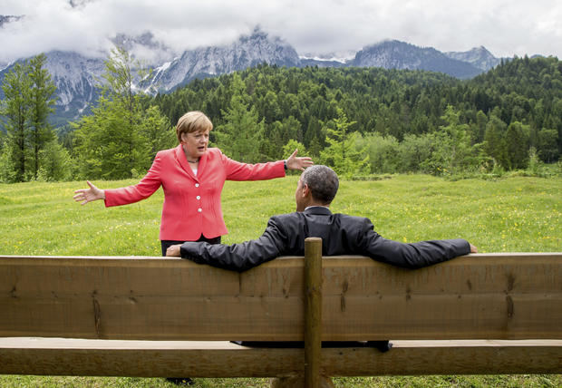German Chancellor Angela Merkel speaks with President Obama outside the Elmau castle in Kruen near Garmisch-Partenkirchen, Germany, June 8, 2015, at a summit of the leaders of the Group of Seven (G7) industrial nations.
