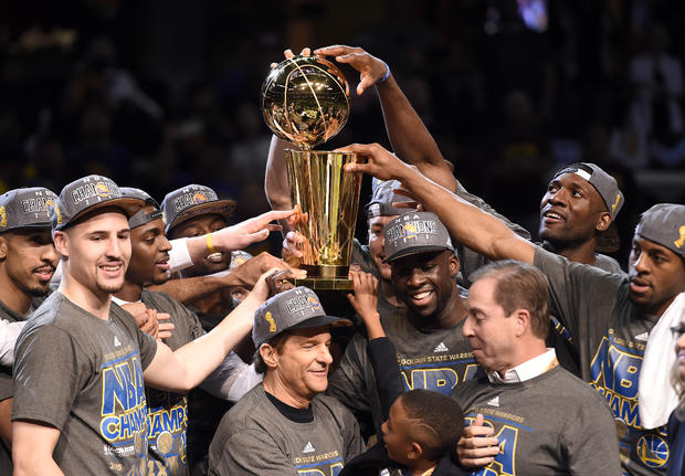 Golden State Warriors celebrate with Larry O'Brien Trophy after beating Cleveland Cavaliers in Game 6 of the NBA Finals at Quicken Loans Arena in Cleveland on June 16, 2015
