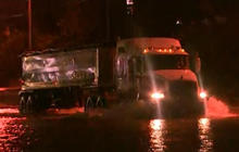 Heavy rain causes flooding as Tropical Storm Bill moves inland