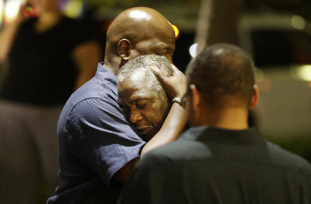 Worshippers embrace following group prayer across street from scene of shooting in historic black church on night of June 17, 2015, in Charleston, S.C.