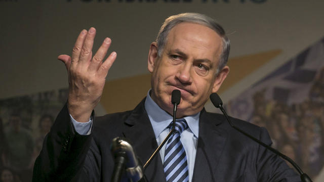 Israel's Prime Minister Benjamin Netanyahu gestures as he addresses the Jewish Agency Assembly in Tel Aviv, Israel