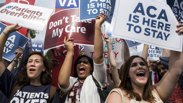 Supporters of the Affordable Care Act celebrate after the Supreme Court upheld the law in a 6-3 vote at the Supreme Court in Washington June 25, 2015.