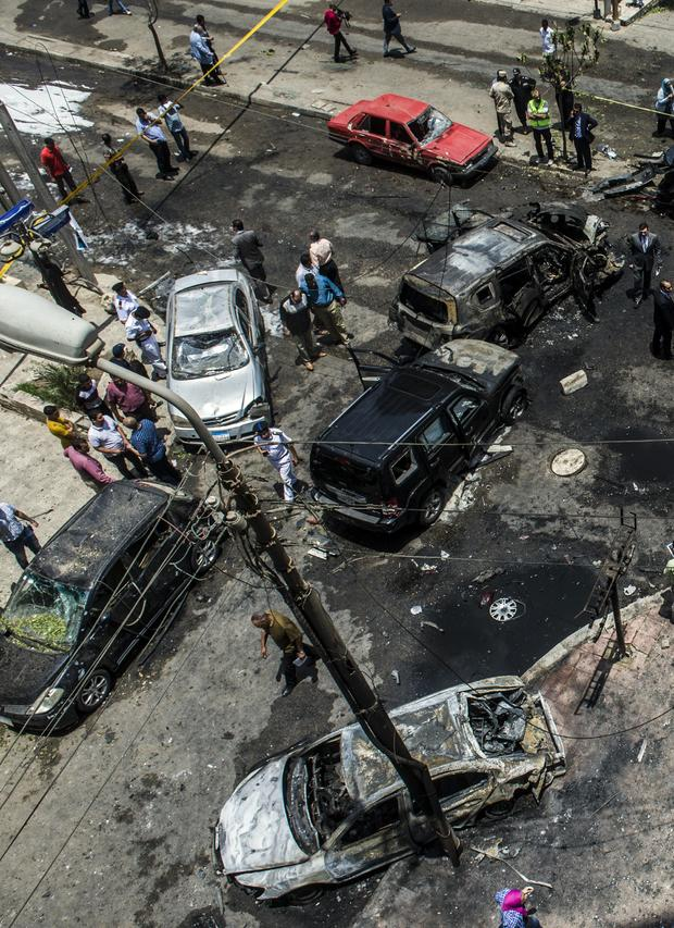 Egyptian security forces stand guard at the site of a bomb that targeted the convoy of the Egyptian state prosecutor, Hisham Barakat, in the capital Cairo