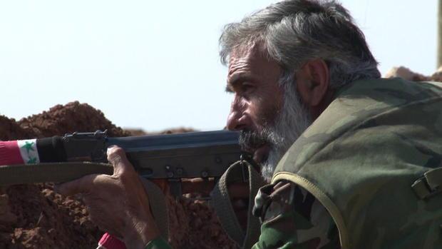 palmer-syria-soldiers-transferframe1580.jpg