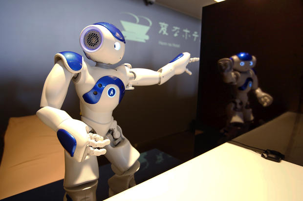 A receptionist robot performs during a demonstration for the media at the new hotel, aptly called Henn na Hotel or Weird Hotel, in Sasebo, southwestern Japan
