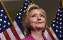 Government inspectors ask DOJ to probe Clinton emails