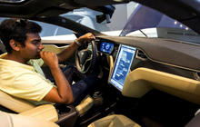 Tesla may begin offering driverless rides