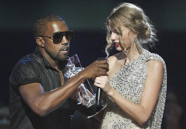 "September 2009 file photo shows Kanye West taking microphone from Taylor Swift as she accepts ""Best Female Video"" award during MTV Video Music Awards in New York"