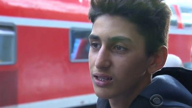 Jawan Kamal, a 16-year-old refugee from Syria, speaks to CBS News in Munich