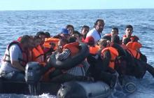 Boats from Greece confront refugees at sea