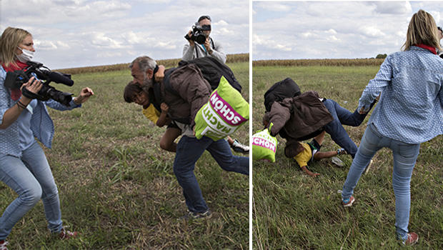 A migrant falls over a child as he tries to run away from the police on a field near a collection point in the village of Roszke