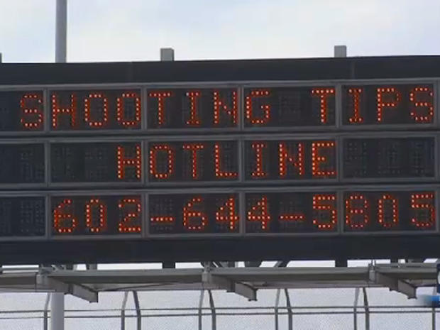 Highway sign is seen in Phoenix on September 9, 2015 uring people to call in tips as authorities pressed their investigation into a series of incidents on city highways in which windows of passing vehicles were shot out
