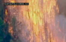 Wildfires tear across eight states in Western U.S.