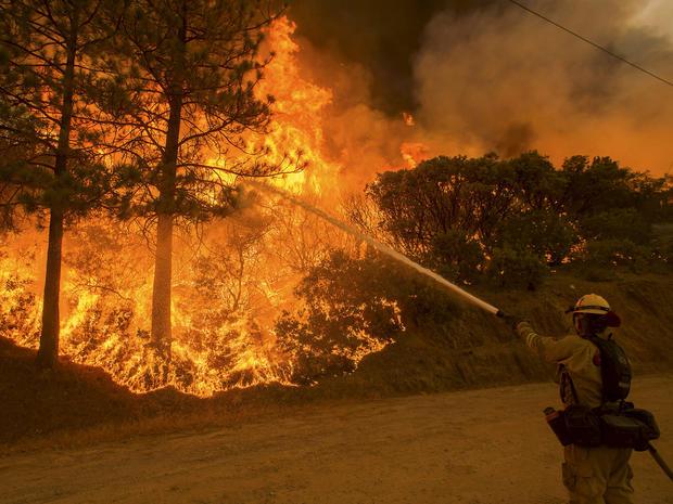 Devastating wildfires rage in California