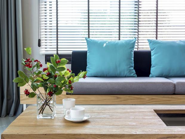 Modern interior of Living room with flower vase, sofa background