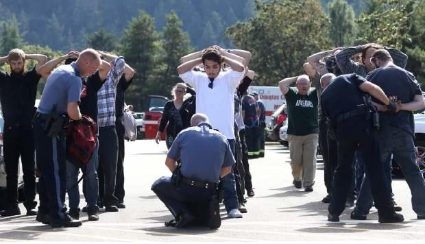 Authorities check bags as students and staff are moved off campus at Umpqua Community College after a shooting Oct. 1, 2015.
