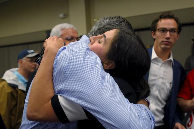 Jeb Bush hugs audience member Nora Barre at campaign town hall meeting Bedford, New Hampshire on September 30, 2015; Barre, whose 14 family members escaped from Syria to Turkey, asked Bush a question about the refugee crisis in the Middle East and Europe