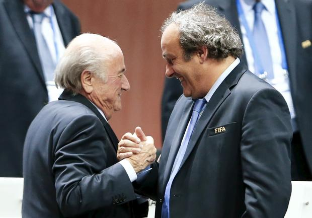 UEFA President Michel Platini (R) congratulates FIFA President Sepp Blatter after he was re-elected at the 65th FIFA Congress in Zurich, Switzerland, in this file picture