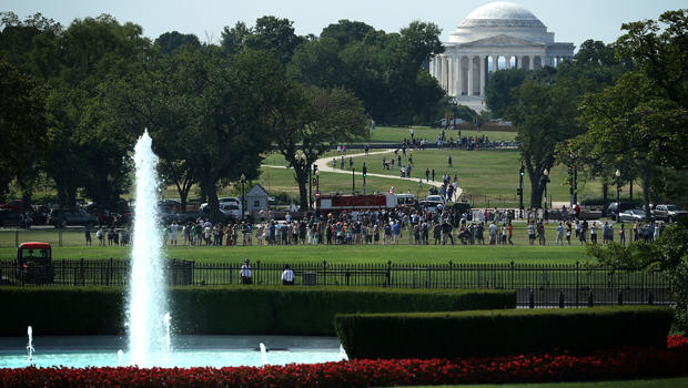 People gather at the Ellipse to watch the departure of President Obama, aboard Marine One, from the White House Aug. 27, 2015, in Washington.