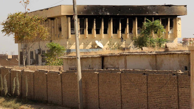A government building damaged during the clashes between Afghan government forces and the Taliban insurgents is pictured in the northern city of Kunduz Oct. 8, 2015.