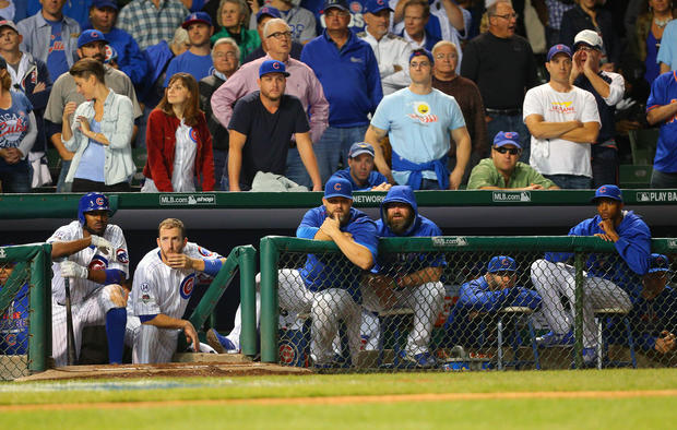Chicago Cubs in their dugout in ninth inning of NLCS game four against New York Mets, who won, 8-3, to sweep the series and move on to World Series