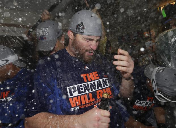 New York Mets second baseman Daniel Murphy celebrates with champagne in clubhouse after Mets defeating Chicago Cubs to win NLCS at Wrigley Field on October 21, 2015 and advance to World Series