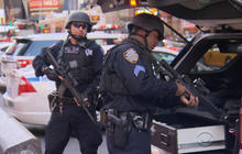 American cities tighten security in wake of Paris attack