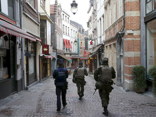 Belgian soldiers patrol a shopping street where tourists frequented in central Brussels