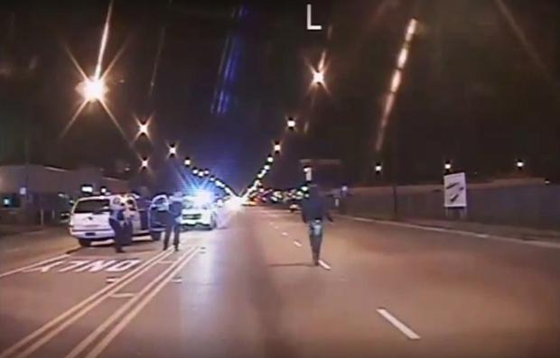 Laquan McDonald, right, walks on road before being shot 16 times by police officer Jason Van Dyke in Chicago, in still image taken from October 20, 2014 police vehicle dash camera video that was released by Chicago police on November 24, 2015.