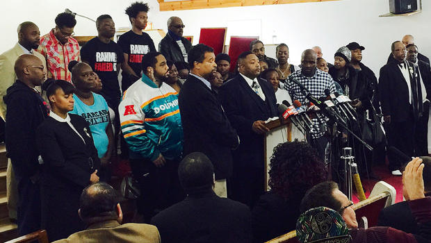 The Rev. Marvin Hunter, center, the great-uncle of Laquan McDonald, accompanied by other family members and supporters, speaks at a news conference Dec. 11, 2015, in Chicago.