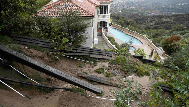 A home with a fence destroyed by a mudslide is seen after an El Nino-strengthened storm brought rain to Pasadena, California, Jan. 6, 2016.