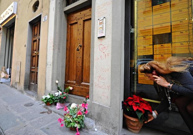 Flowers are laid outside the apartment of 35-year-old American Ashley Olsen in Florence