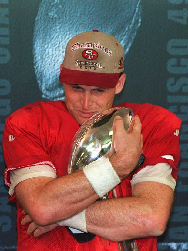 San Francisco 49ers quarterback Steve Young hugs the Vince Lombardi Trophy Jan. 29, 1995, after being named the most valuable player of Super Bowl XXIX.