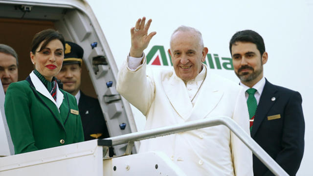 ​Pope Francis waves as he boards a plane at Fiumicino Airport in Rome, Italy, Feb. 12, 2016.
